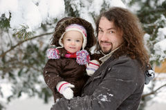 Little winter baby girl and her father Royalty Free Stock Images