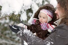 Little winter baby girl and her father Stock Photography