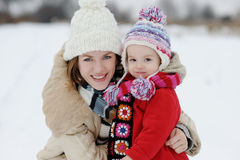 Little winter baby girl and her young mother Stock Image