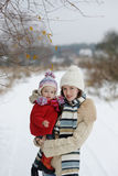Little winter baby girl and her young mother Royalty Free Stock Images