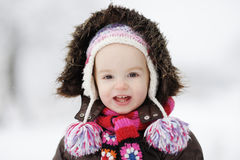 Little winter baby girl smiling Stock Image