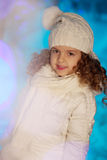 Little winter girl with rabbit Royalty Free Stock Photography