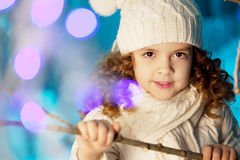 Little winter girl with rabbit Royalty Free Stock Image