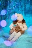 Little winter girl with rabbit Stock Image