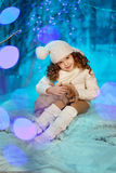 Little winter girl with rabbit Stock Photos