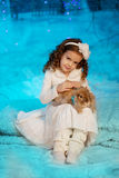 Little winter girl with rabbit Stock Photo