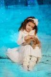 Little winter girl with rabbit Stock Photo