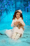 Little winter girl with rabbit Stock Images
