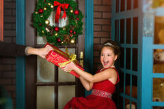Little winter Princess accepts a Christmas gift Stock Photo