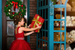 Little winter Princess accepts a Christmas gift royalty free stock photography