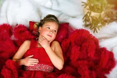Little winter Princess lies on artificial New year snow Stock Photography