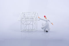 Little wired metal model house and a Sufi dervish Stock Photography