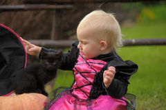 Little witch. With a black kitten Royalty Free Stock Images