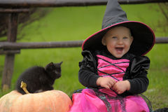 Little witch. With a black kitten Stock Image