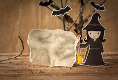 Little witch with blank paper. Royalty Free Stock Photography