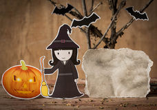 Little witch with blank paper. Royalty Free Stock Photo
