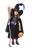 Little witch with a broom and pumpkin Royalty Free Stock Photo
