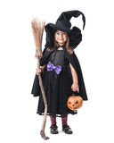 Little witch with a broom and pumpkin Stock Photography