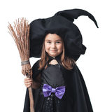 Little witch with a broom Stock Photos