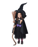 Little witch with a broom Stock Photography