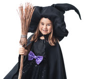 Little witch with a broom Royalty Free Stock Photos
