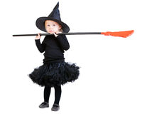 Little witch with broomstick Stock Photos