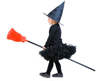 Little witch on broomstick. Adorable little witch flying on broomstick isolated on white royalty free stock photography