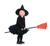 Little witch on broomstick. Adorable little witch flying on broomstick isolated on white royalty free stock image