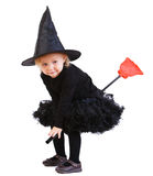 Little witch on broomstick. Adorable little witch flying on broomstick isolated on white stock photography