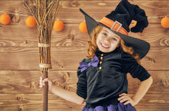 Little witch with a broomstick Stock Images