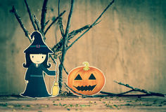 Little witch with halloween background. Stock Photo