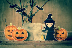 Little witch with halloween background. Stock Images