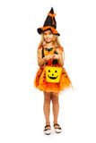 Little witch with Halloween bucket Royalty Free Stock Images