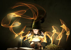 Little witch. Little Halloween witch reading conjure from magic book above pot Royalty Free Stock Photos