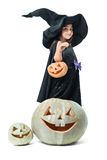 Little witch holding a pumpkin Stock Photo