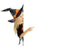 Little witch holding a sign Royalty Free Stock Photography
