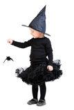 Little witch holding small bat Royalty Free Stock Photos