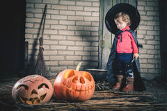 Little witch making a magic potion at Halloween night. Horror. Royalty Free Stock Image