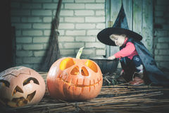 Little witch making a magic potion at Halloween night. Horror. Stock Photos