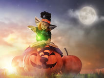 Little witch outdoors Royalty Free Stock Photos