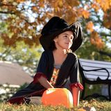 Little Witch in the Park Royalty Free Stock Photography