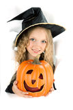 Little witch peeking through a hole in white paper Stock Photography