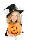 Little witch peeking through a hole in white paper Royalty Free Stock Photography