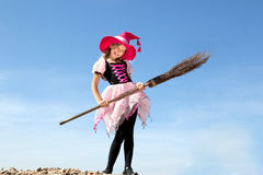 Little witch peeking through a hole in white paper Royalty Free Stock Images
