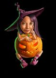 Little witch with pumpkin Stock Photography