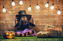 Little witch with a pumpkin. stock photography