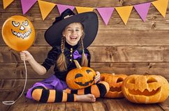 Little witch with a pumpkin royalty free stock images