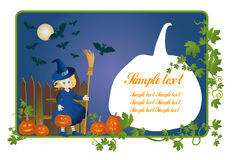 Little witch with a pumpkin-lantern on Halloween Royalty Free Stock Photo