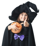 Little witch showing thumbs up Stock Photo