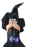Little witch shows the collected candy Stock Image